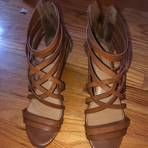 Strapped brown heeled sandals